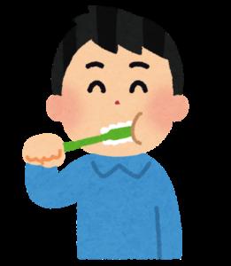 歯磨きする男の人